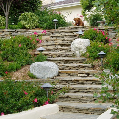 Photo of a traditional full sun hillside stone retaining wall landscape in San Diego.