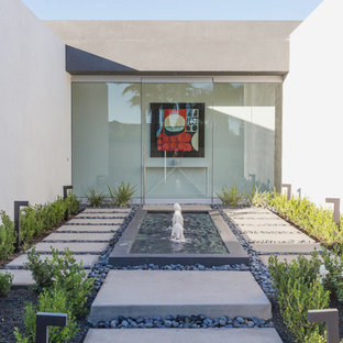 Photo of a contemporary courtyard concrete paver water fountain landscape in Other.