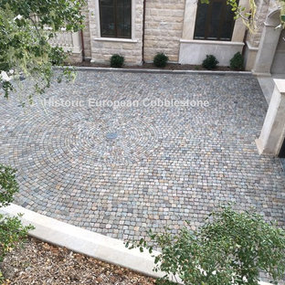 This is an example of a large traditional shade courtyard stone driveway in San Francisco.
