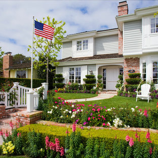 This is an example of a traditional front yard brick landscaping in Orange County.