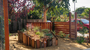 Repurposed wooden planters and Redwood fence.