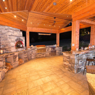 This is an example of a large traditional full sun backyard concrete paver landscaping in Portland for spring.