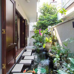 Modelo de jardín asiático con fuente y exposición parcial al sol