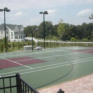 This is an example of a huge contemporary partial sun backyard brick outdoor sport court in DC Metro for summer.