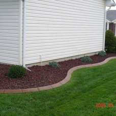Traditional Landscape by Curb Appeal
