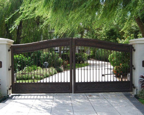 Photo of a mediterranean front yard driveway in Houston. Front Gate   Houzz