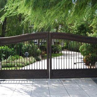 Photo of a mediterranean front driveway garden in Houston.