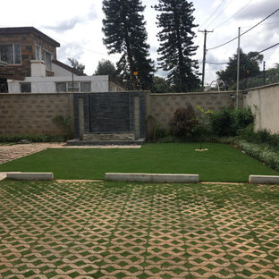 This is an example of a contemporary front yard stone landscaping in Other.