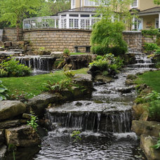 Traditional Landscape by Pond and Fountain World, Inc.