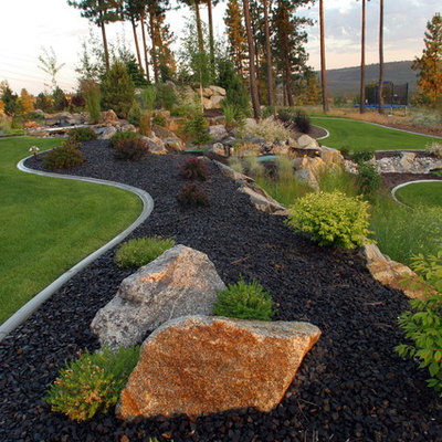 Inspiration for a large contemporary backyard mulch landscaping in Seattle.