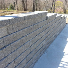 Traditional Landscape Retaining walls, stairs and concrete driveway.