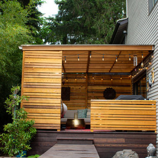 Photo of a small asian privacy and shade backyard landscaping in Portland with decking for summer.