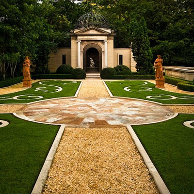 This is an example of a huge mediterranean courtyard formal garden in Nashville.
