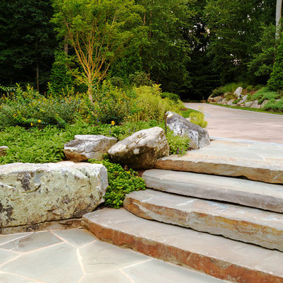 Inspiration for a transitional hillside stone landscaping in DC Metro.