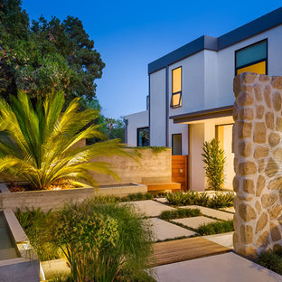 This is an example of a contemporary front partial sun garden in Santa Barbara with concrete paving.