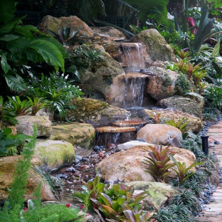 Rock waterfall tropical garden pond