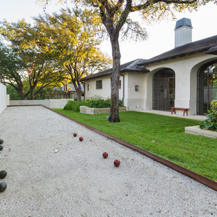 Design ideas for a mid-sized mediterranean partial sun side yard gravel landscaping in Austin for spring.