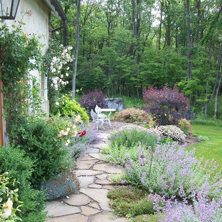Photo of a shabby-chic style backyard stone landscaping in Philadelphia for summer.