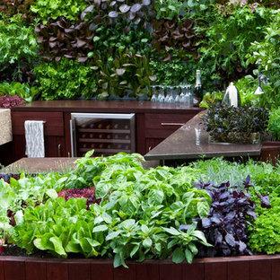 Idee per un piccolo giardino formale design sul tetto con pedane