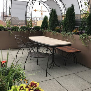 This is an example of a small eclectic full sun rooftop concrete paver formal garden in Minneapolis for summer.