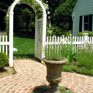 Traditional backyard garden in DC Metro with brick pavers.