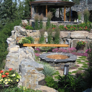 Photo of an eclectic landscaping in Calgary with a fire pit.