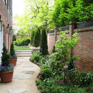 Design ideas for a mid-sized traditional full sun side yard stone landscaping in DC Metro.