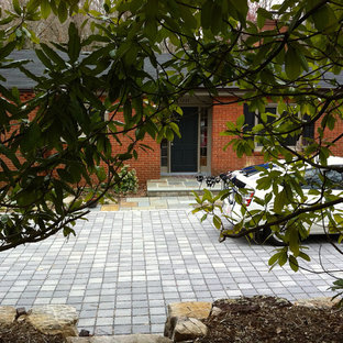 Design ideas for a small modern partial sun front yard concrete paver driveway in Richmond for winter.