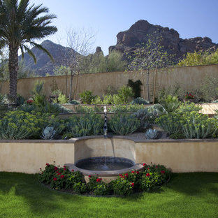 This is an example of a mediterranean retaining wall landscape in Phoenix.