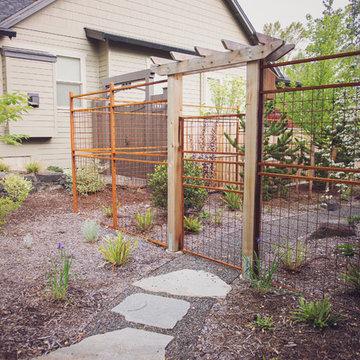 Rusted Steel Mesh Deer Fence + Garden Gate Arbor