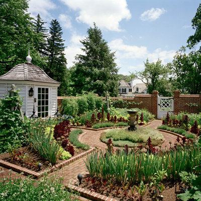 Inspiration for a large farmhouse full sun courtyard brick landscaping in New York.