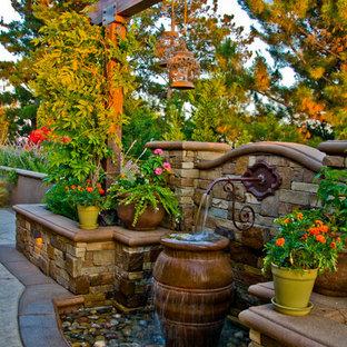 Design Ideas For A Mediterranean Water Fountain Landscape In Orange County.