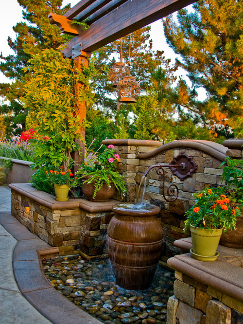 Design Ideas For A Mediterranean Water Fountain Landscape In Orange County.