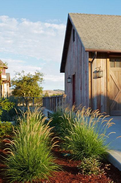 Rustic Landscape by Addison Landscape & Maintenance, Inc.