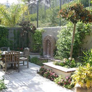 Design ideas for a mediterranean courtyard water fountain landscape in Orange County.