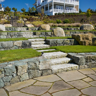 Inspiration for a coastal full sun garden in Providence with natural stone paving and a rockery.