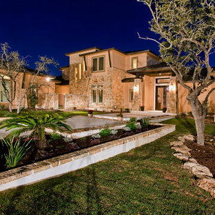 Inspiration for a large mediterranean partial sun front yard stone formal garden in Austin.