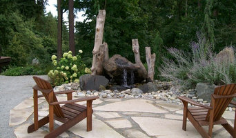 Sandstone patio with natural rock water feature