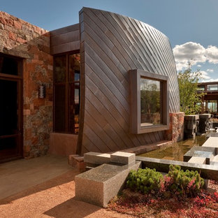 Design ideas for a large southwestern full sun front yard gravel landscaping in Albuquerque.
