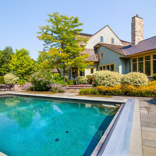 This is an example of a huge farmhouse full sun backyard stone landscaping in Boston for summer.