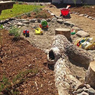 Inspiration for a mid-sized mediterranean drought-tolerant and full sun backyard gravel outdoor playset in San Diego.
