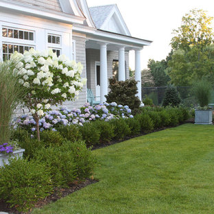 This is an example of a large nautical front partial sun garden in Boston.