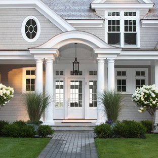 Inspiration for a large beach style partial sun front yard landscaping in Boston.