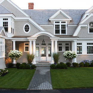 Design ideas for a large beach style partial sun front yard concrete paver landscaping in Boston.