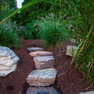 This is an example of a large mid-century modern full sun backyard stone garden path in Portland for spring.