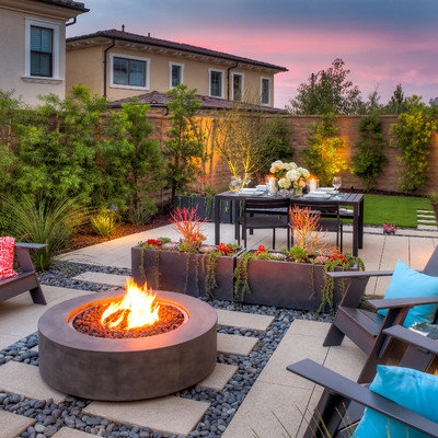 This is an example of a small modern drought-tolerant and partial sun backyard concrete paver landscaping in Orange County.