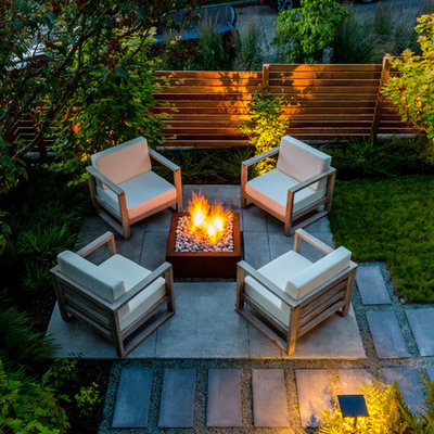 Inspiration for a small contemporary partial sun backyard concrete paver landscaping in Seattle with a fire pit.