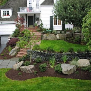 This is an example of a large contemporary full sun front yard brick garden path in Seattle.