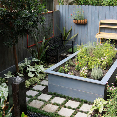 Design ideas for a small eclectic partial sun backyard concrete paver landscaping in Houston.