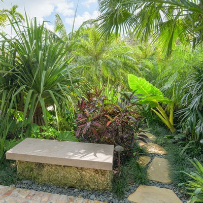 Design ideas for a mid-sized tropical full sun brick landscaping in Miami.